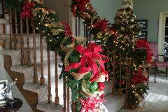 Garland up the stairs  - Holiday Decorations in Omaha, NE | Vickie Lea Designs