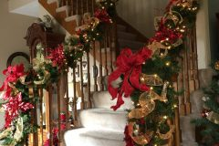 Side View of Garland Up the Stairs - Holiday Decorations in Omaha, NE | Vickie Lea Designs